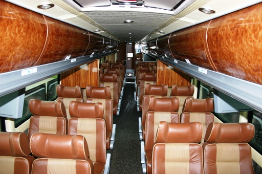 The Interior Features Piped Leather Seats To Comfortably Accommodate 42 People With Ample Leg Room Custom Tour Bus