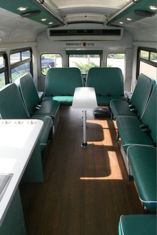 Short on school bus long on tailgating fun for Custom party bus interiors